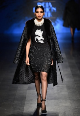 Black Quilted Leather Jacket, Dragon Encrusted T-Shirt and Embellished Skirt