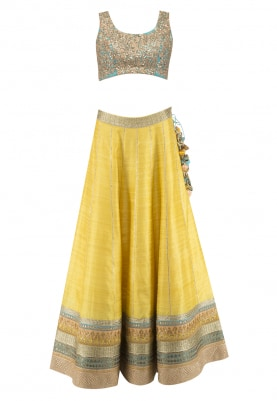 Yellow Raw-Silk Lehenga and Turquoise Choli Paired with Sequin Dupatta.