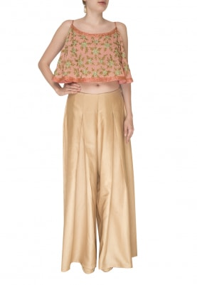 Pink Circular Flare Crop Top Paired with Beige Pants