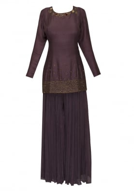 Wine short kurta with floral and tassel work paired with flared palazzo